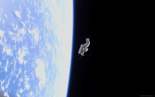Download Gravity Astronaut Drifting In Space Wallpaper